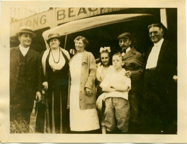 1920 Bill, Jean and C.A. Matthews by Long Beach sign