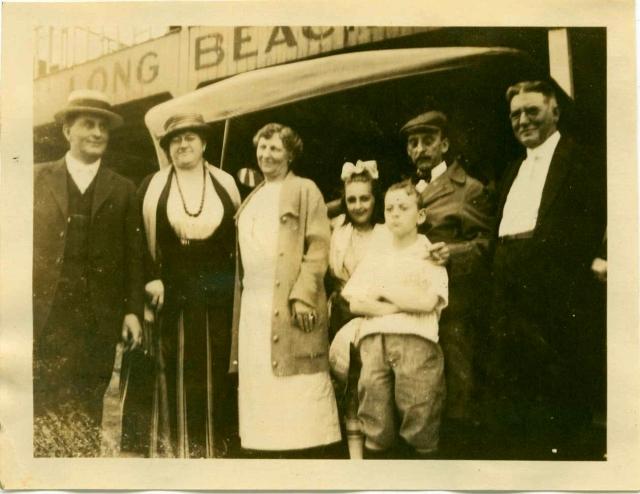 1920 Bill, Jean and C.A. Matthews by Long Beach sign